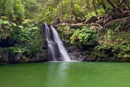 Lush and green Waikamoi Falls in Maui, HI along the road to Hana with a great pool for swimming