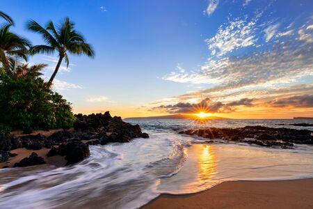 Sunset at Makena Secret Beach in Wailea, Maui, HI with sunstar