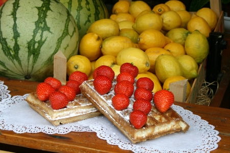 Fruit stall with strawberry waffles photo