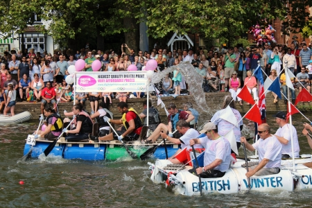 Bedford, England - July 22 - People race self built rafts down the River Great Ouse at the bi-annual Bedford River Festival on 22 July 2012 in England Stock Photo - 14628810