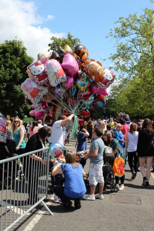 Bedford, England - July 21 - A balloon seller walks around the streets during the bi-annual Bedford River Festival in England on 21 July 2012