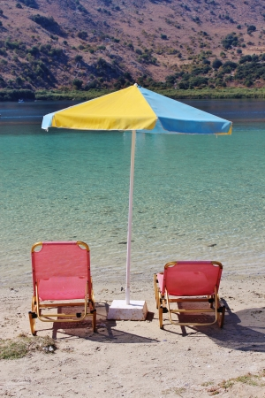 Sunbeds and parasol, Kournas Lake, Crete photo