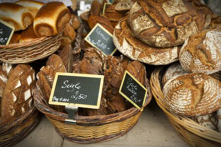 Different kinds of bread in a stall of the jacobean market in Le Mans, France. photo