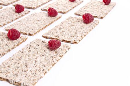 Raspberries over crispbread  photo