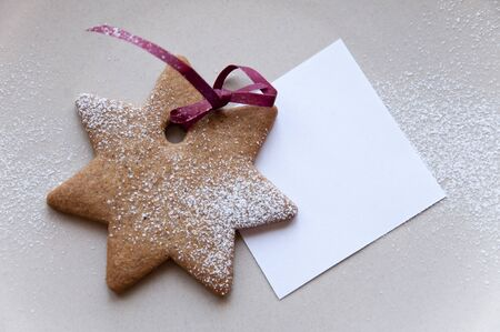Holiday cookie star with paper note  photo