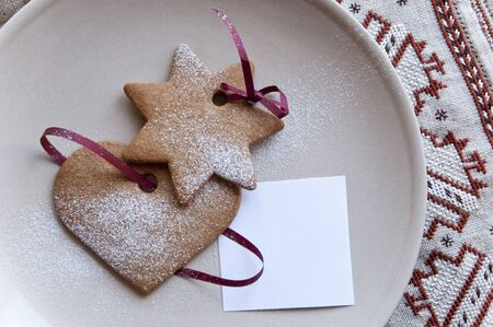 Heart and star cookies with paper note  photo
