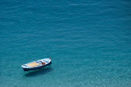 Boat suspended over the water. Scilla, Calabria photo