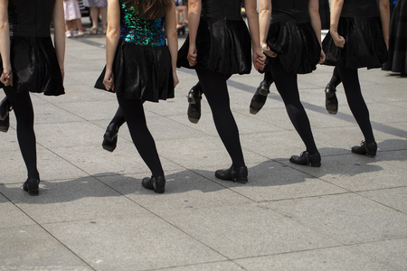 Irish dancers are dancing