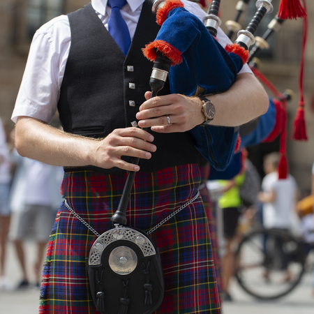 Man playing bagpipe, scottish traditional pipe band Stock Photo