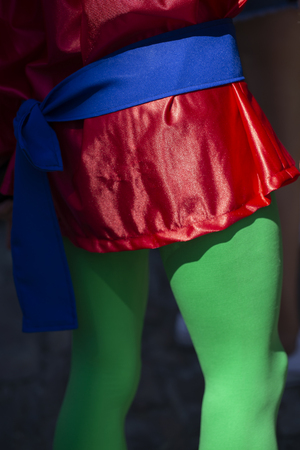Man disguised wearing green tights