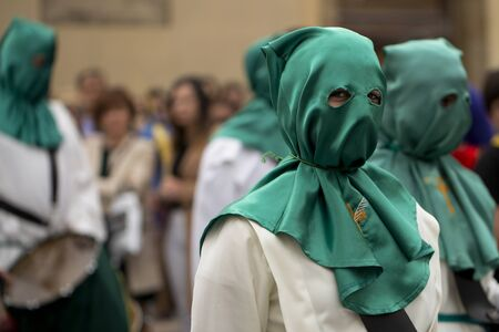 Portrait of a hooded person looking at camera, Holy Week
