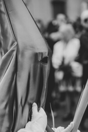 Hooded person in a procession, Holy Week
