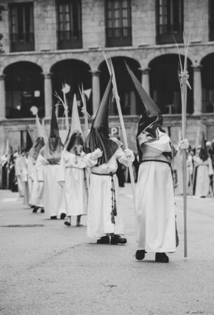 Hooded people in a procession, Holy Week