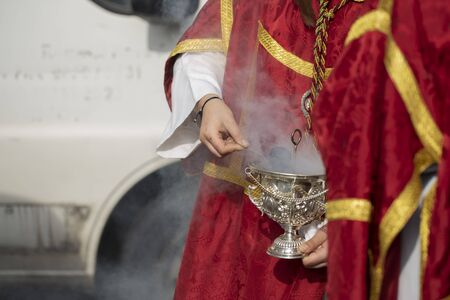 Child holding a censer in a procession, Holy Week