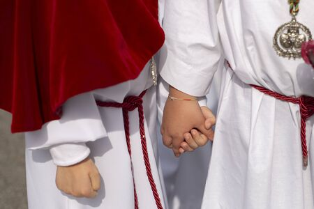 Interlaced hands in a procession, Holy Week