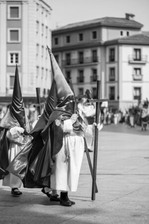 Hooded people in a procession. Holy Week