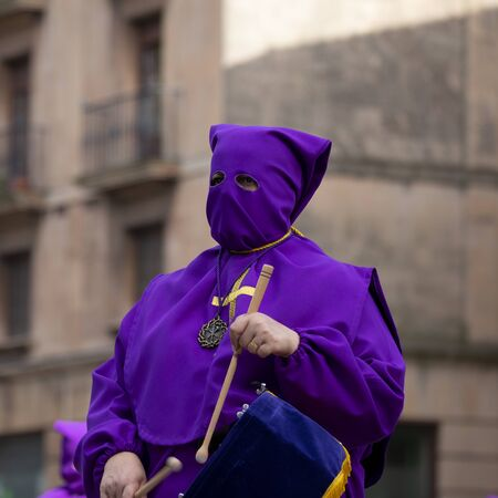 Purple penitent, Holy Week