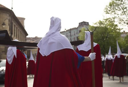 Rear view of hood penitents in a procession, Holy Week Stok Fotoğraf