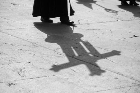 Shadow of a cross in a procession, Holy Week Stok Fotoğraf