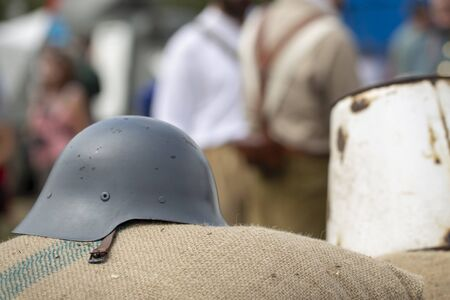 Combat helmet and blurred people
