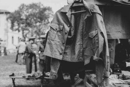 Military jacket hanging and blurred solders behind