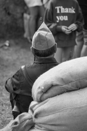 Rear view of a soldier and thank you in a sweater