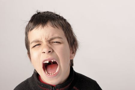 young boys screaming with missing teeth focus on the eyes