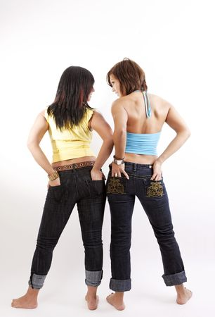 two woman back in jeans on a white background