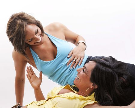 two woman smiling while having fun on a white background photo