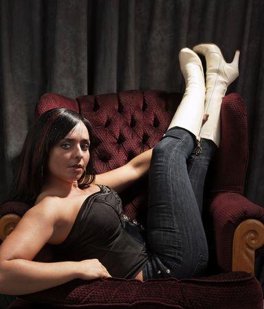 cute woman looking at camera on a sofa photo