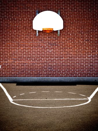 outdoor basketball court: empty basketball court from a school