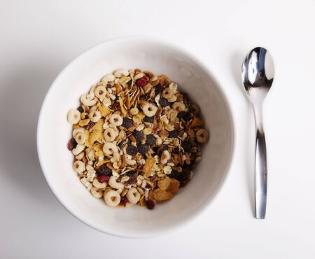 white bowl of cereal and spoon for the brealfast Stock Photo - 4753125