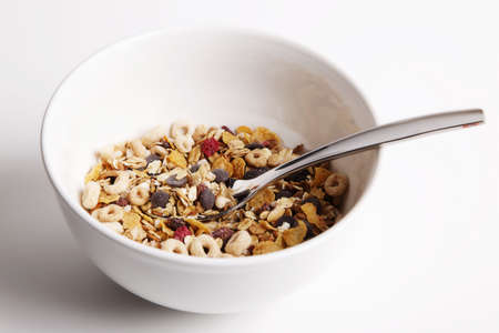white bowl of cereal and spoon for the brealfast Stock Photo