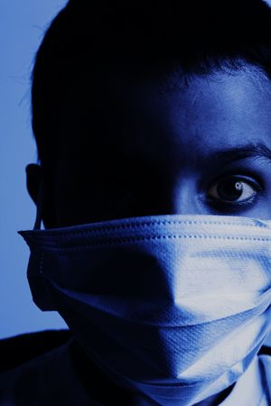 young boy with health mask for is protection again virus. Tinted in blue with high contrast photo