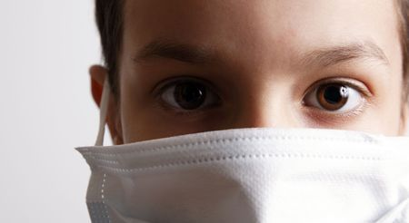young boy with health mask for is protection again virus. White background Stock Photo