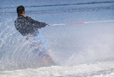 waterskiing during the summer on a lake photo