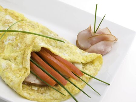 omelet on a white plate with ham,cheese and sweet pepper Stock Photo - 5505502