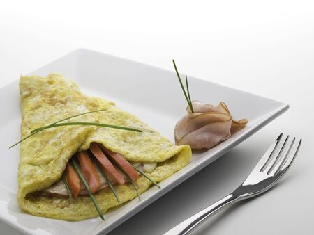 omelet on a white plate with ham,cheese and sweet pepper Stock Photo - 5505503