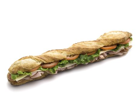 long: fresh submarine sandwich with ham,tomato,cheese and salad on a white background Stock Photo