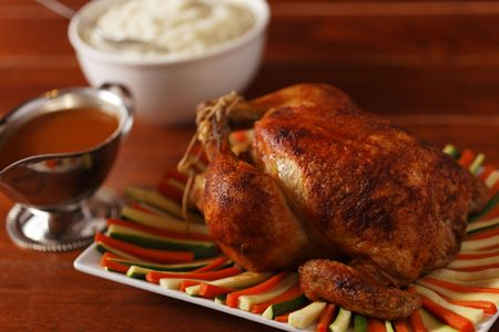 roasted chicken on a plate with vegetable. Very shallow depth of field. photo
