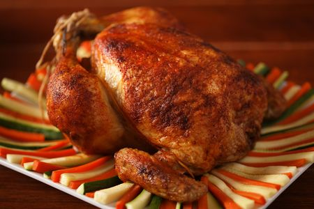 roasted chicken on a plate with vegetable. Very shallow depth of field. Stock Photo