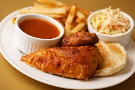 Roast chicken quarter breast with french fries, cole slaw salad and bbq sauce on the side. Shallow depth of field. Stock Photo - 6400992
