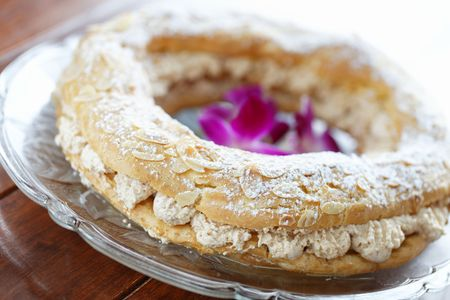 brest: paris brest dessert on a glass plate with very shallow depth of field. Stock Photo