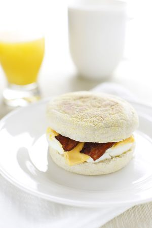 breakfast sandwich with egg,cheese and bacon in english muffin bread. photo