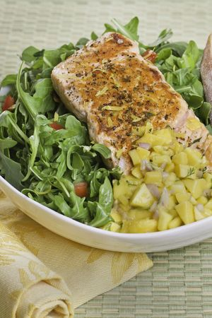 Grilled atlantic salmon fish on salad. Fruit salsa on the side. Very sharp. Stock Photo - 7817004