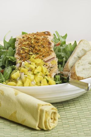 Grilled atlantic salmon fish on salad. Fruit salsa on the side. Very sharp.  Stock Photo - 7817005