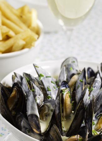 Mussel with white wine sauce and french frie  on a plate. Very shallow depth of field. Stock Photo - 7946837