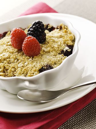 Cobbler fruit desert with fresh rasberry and berry on the top. Stock Photo - 8238124