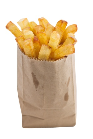 fries: French fries in a small brown paper bag.  Shallow depth of field. Stock Photo