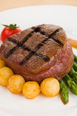 Tenderloin steak in a white plate with vegetable. Shallow depth of field. Stockfoto